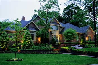 Photo of home with outdoor lighting